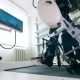 Electronic Medical Robotic for Rehabilitation. Patient Is Exercising To Walk on a Special Machine - VideoHive Item for Sale