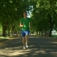 Athletic Young Man Running in Public Park - VideoHive Item for Sale