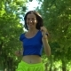 Female Runner Jogging During Outdoor Workout in Park - VideoHive Item for Sale