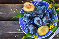 Fresh  ripe blue plums on plate - PhotoDune Item for Sale