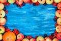Autumn frame of apples, pumpkin, rowan on  painted blue wooden b - PhotoDune Item for Sale
