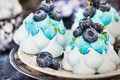 Delicious blueberry Pavlova meringue cakes decorated with cream - PhotoDune Item for Sale
