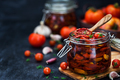Sun dried tomatoes with garlic and olive oil in a jar - PhotoDune Item for Sale
