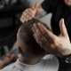 Tattoed Barber Makes Hair Styling with Hair Gel for Customer After Haircut at the Barber Shop, Man's - VideoHive Item for Sale