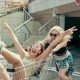 Young Hipster Teen Girls Having Fun Riding in Shopping Cart at Parking - VideoHive Item for Sale