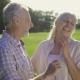 Funny Elderly Couple Laughing at a Joke Outdoors - VideoHive Item for Sale