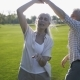 Positive Mature Couple Dancing and Singing on Lawn - VideoHive Item for Sale