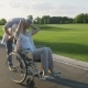Senior Couple with Wife in Wheelchair on a Walk - VideoHive Item for Sale