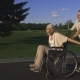 Aged Man Running While Pushing Wife in Wheelchair - VideoHive Item for Sale