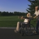 Man with Wife in Wheelchair Enjoying Outdoors - VideoHive Item for Sale