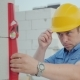 An Engineer in a Yellow Helmet Checks the Accuracy of the Construction Work - VideoHive Item for Sale