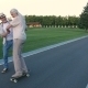 Husband Teaching Wife To Skateboard in Summer Park - VideoHive Item for Sale