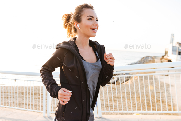 Attractive young sports woman running. - Stock Photo - Images