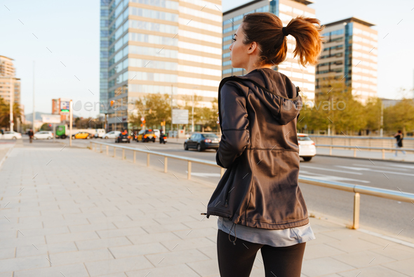 Young sports woman running outdoors on the street. - Stock Photo - Images