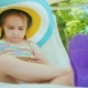 Little Business Woman on Vacation. Sits in a Deckchair, Uses a Smartphone - VideoHive Item for Sale
