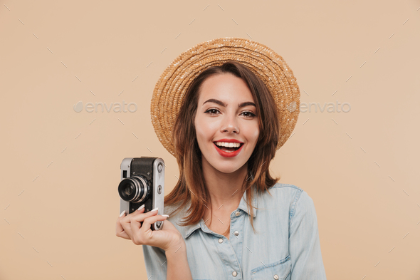 Portrait of a happy young girl holding photo camera - Stock Photo - Images