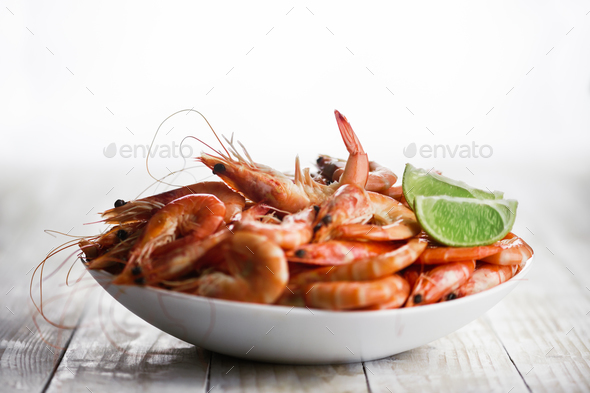 Big boiled shrimps in white plate - Stock Photo - Images