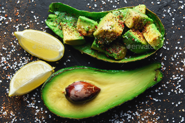 Fresh avocado fruit on a wooden board - Stock Photo - Images