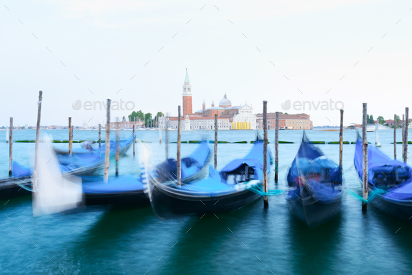 Row of gondolas parked on city pier - Stock Photo - Images