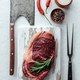 Marbling ribeye steak on white plate - PhotoDune Item for Sale