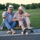 Stylish Senior Couple Sitting with a Skateboard - VideoHive Item for Sale
