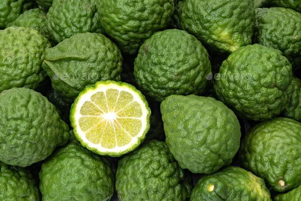 Kaffir limes, one cut citrus fruit for herbal medicine - Stock Photo - Images