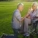 Senior Man on Knee Proposing Woman on Wheelchair - VideoHive Item for Sale