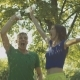 Excited Couple Runners Pouring Water Over Themselves - VideoHive Item for Sale