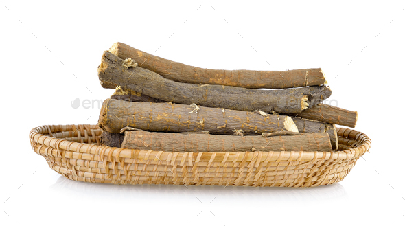 Liquorice roots in basket on white background - Stock Photo - Images