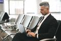 Confident businessman using laptop computer - PhotoDune Item for Sale