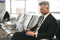 Smiling businessman using laptop computer - PhotoDune Item for Sale