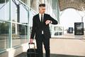 Serious businessman dressed in suit walking - PhotoDune Item for Sale