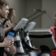 Awesome Girl in Red Shirt Vigorously Works on Exercise Bike and Guy Comes To Ask Her Name and To - VideoHive Item for Sale