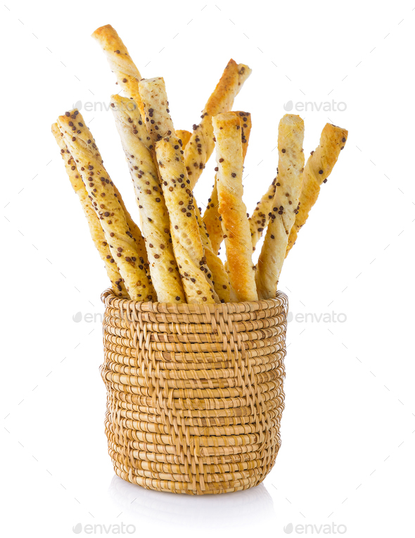 pile of delicious pretzel sticks in basket isolated on white bac - Stock Photo - Images