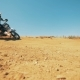 Motorcycler Is Riding Through Sand and Raising Clouds of Dust - VideoHive Item for Sale