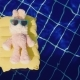 A Pink Bunny in Sunglasses Is Floating on an Inflatable Mattress in the Pool - VideoHive Item for Sale