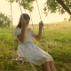 Girl with Long Hair Smiling Swaying on a Swing - VideoHive Item for Sale