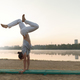 Young athletic man doing yoga poses near the lacke - PhotoDune Item for Sale
