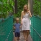 Young Woman and Her Son Walking on the Hanging Suspension Bridge - VideoHive Item for Sale