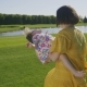 Joyful Mother Spinning Speial Needs Girl in Park - VideoHive Item for Sale