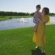 Mother Walking on Grass Embracing Toddler Daughter - VideoHive Item for Sale