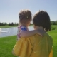 Mom and Special Need Daughter Walking on Meadow - VideoHive Item for Sale