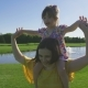 Laughing Special Needs Girl on Mom's Shoulders - VideoHive Item for Sale