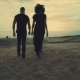 Couple Walking in Desert at Sunset - VideoHive Item for Sale