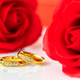 Red roses and gold rings on white_-11 - PhotoDune Item for Sale