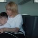 A Happy Family. Mum and Son Read a Book. - VideoHive Item for Sale