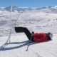 Skier Resting In The Mountains Lying On The Snow And Legs Up With Skis - VideoHive Item for Sale