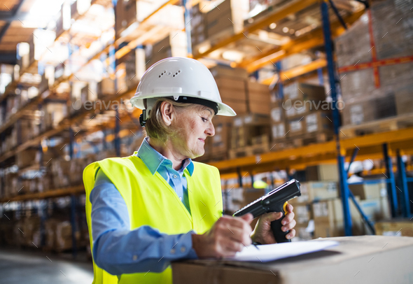 Senior warehouse woman worker with barcode scanner. - Stock Photo - Images