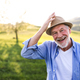 Portrait of a senior man in spring nature. Copy space. - PhotoDune Item for Sale