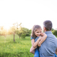 Father holding a small daughter in spring nature at sunset. - PhotoDune Item for Sale
